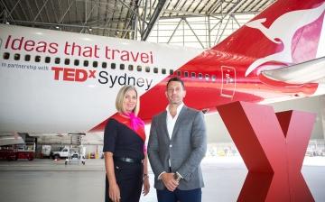 Assoc Prof Michael Biercuk and Qantas crew member