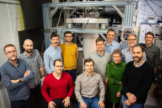 A photograph of 12 members of the Australian Quantum Vortex team in one of their labs.